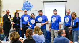 Apache Cedar Rapids Health and Wellness committee cut the ribbon to officially designate Apache as Blue Zones Certified